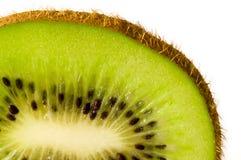 Fine della fetta del Kiwi in su Fotografia Stock