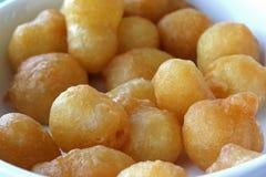 Fine della palla della ciambella del miele su Fotografia Stock