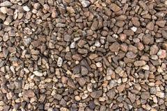 Fine della pietra schiacciata granito su struttura Immagine Stock