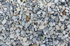 Fine della roccia delle macerie di Grey Stone su struttura, fondo senza cuciture Immagine Stock