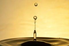 Fine della spruzzata della goccia di acqua su fotografia stock