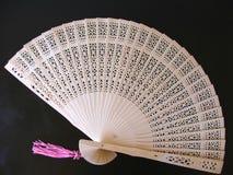 Fine design. Wooden fan Royalty Free Stock Image