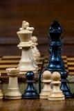 Fine dettagliata su delle figure in bianco e nero di scacchi Fotografia Stock Libera da Diritti