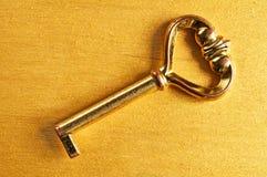 Fine di chiave dorata su Fotografie Stock