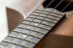 Fine di Fretboard delle ukulele su fotografia stock