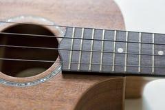 Fine di Fretboard delle ukulele su immagini stock
