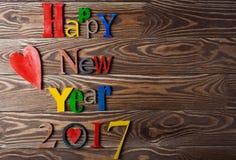 Fine di legno multicolore del buon anno dell'iscrizione su Immagine Stock