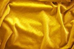 Fine di seta dorata del velluto su Immagine Stock