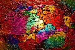 Fine di vetro di struttura colorata Cracked su immagine stock