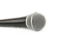 Fine di vista laterale del microfono su su bianco Immagini Stock