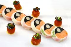 Fine Dining Cold Display: Slow cooked salmon. Slow cooked salmon with green chipotle sherry chutney. Served with confit cherry tomato Stock Image