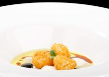 Fine dining, deep fried scallops with olive oil, cheese Stock Image