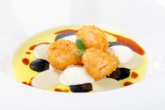 Fine dining, deep fried scallops with olive oil, cheese Stock Photo