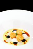 Fine dining, deep fried scallops with olive oil, cheese Royalty Free Stock Images