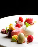 Fine dining dessert, Raspberry Parfait, ice cream, white chocolate Stock Photos