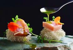 Fine dining, fresh raw ahi tuna sashimi served on an ocean sponge Royalty Free Stock Photography
