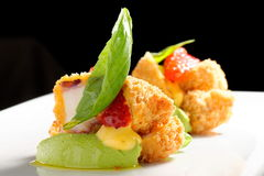 Fine dining, Fried Octopus on basil mousse Stock Photography