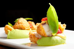 Fine dining, Fried Octopus on basil mousse Royalty Free Stock Images