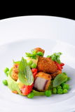 Fine dining, Fried Octopus on basil mousse, green peas Stock Images
