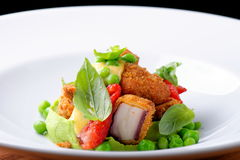 Fine dining, Fried Octopus on basil mousse, green peas Royalty Free Stock Images
