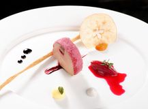 Fine dining, Goose Foie gras with black garlic Royalty Free Stock Photography