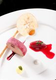 Fine dining, Goose Foie gras with black garlic Stock Photo