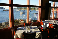Fine dining with harbor view Stock Images