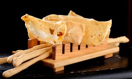Fine dining Italian appetizers, Grissini bread sticks. And crackers with salt Royalty Free Stock Photos