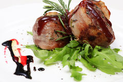 Fine dining meal, delicious lamb. Delicious lamb in company of rucola leaves,  All sprinkled with oriental sauce Royalty Free Stock Image
