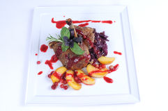 Fine dining meal -Roast duck with apples cranberry Stock Photo
