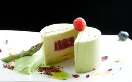 Fine dining, piece of pistachio cake Royalty Free Stock Photos