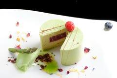 Fine dining, piece of pistachio cake Stock Image