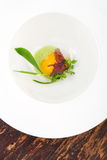 Fine dining, Poached Egg with spinach sauce and Truffel Stock Images