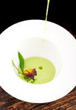 Fine dining, Poached Egg with spinach sauce and Truffel Stock Photos
