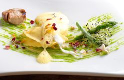 Fine dining, ravioli with asparagus and Porcini. Mushrooms Stock Images