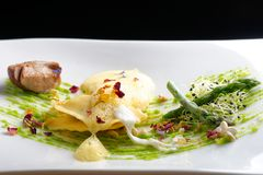 Fine dining, ravioli with asparagus and Porcini Royalty Free Stock Image