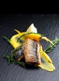 Fine dining Seabass fillets on carrot potato
