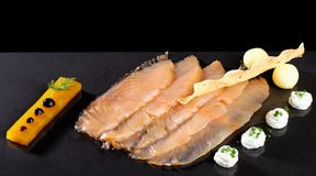 Fine dining, smoked salmon with mango jelly Royalty Free Stock Image