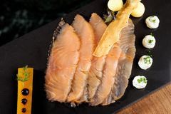 Fine dining, smoked salmon with mango jelly Royalty Free Stock Images