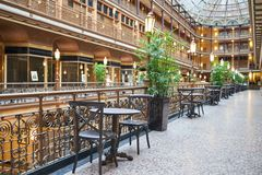 Fine Dining Table and Chair. Chair and table for dining at the Old Arcade in Downtown Cleveland. Given National Historic Landmark status in 1975, the Arcade in Stock Images