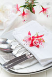 Fine dining - table decorated with flowers Stock Photography