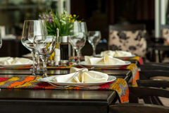 Fine Dinning. Elegance shot of fine dinning set in hotel restaurant. Vacation and leisure theme Royalty Free Stock Photos