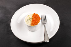 Fine dinning with a small bowl mashed potato, salmon caviar and Stock Photography