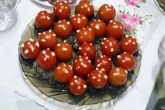 Cherry tomatoes with original pate. stock images