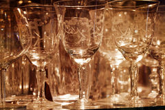 Fine Drinking Glassware on Display Glass Shelf Royalty Free Stock Image