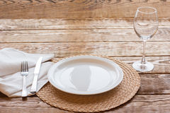 Fine empty tableware on wooden background. Fine empty  tableware on a wooden table is ready for tasting delicious. Top view on table laying Royalty Free Stock Photos