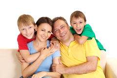 Fine family in bright T-shirts Stock Images