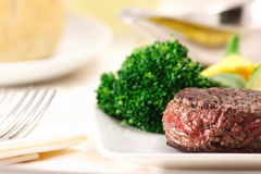 Fine fillet. Prime Fillet Mignon Steak served with fresh steamed vegetables Royalty Free Stock Photo