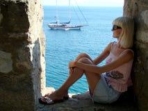 Fine girl. Admires the sea Royalty Free Stock Photo
