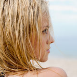 Fine girl with wet hair. Portrait of attractive young long-haired blond woman Stock Photography
